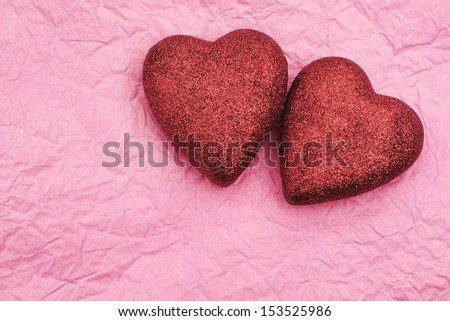 Cute hearts on pink paper - stock photo