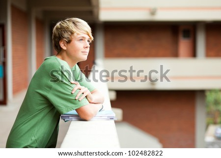 cute high school student looking up - stock photo
