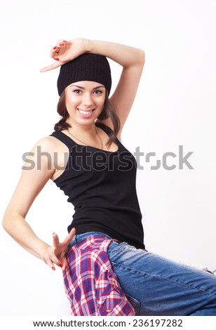 Cute hipster teenage girl with beanie hat posing looking at camera