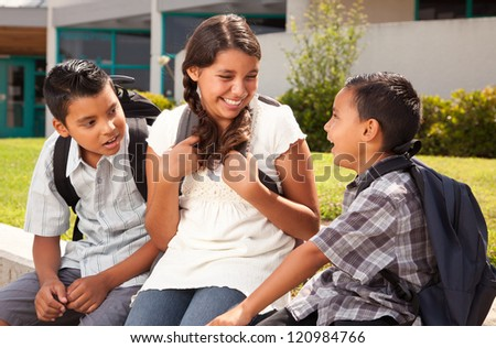 Cute Hispanic Brothers and Sister Talking Ready for School on Morning. - stock photo