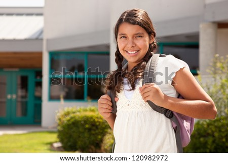 Cute Hispanic Teen Girl Student with Backpack Ready for School. - stock photo