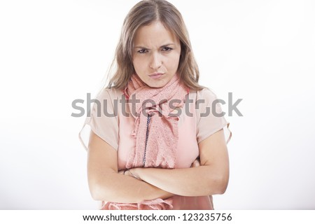 Cute hispanic woman frowning and disapproving - stock photo