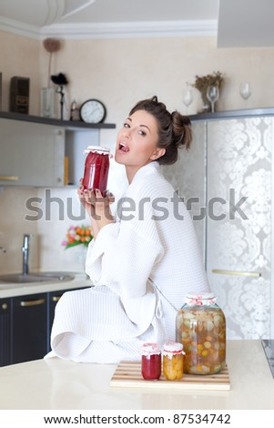 Cute housewife with fruit preserves - stock photo
