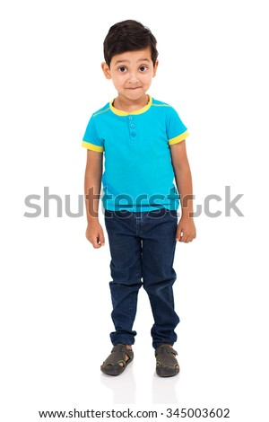 cute indian boy looking at the camera - stock photo