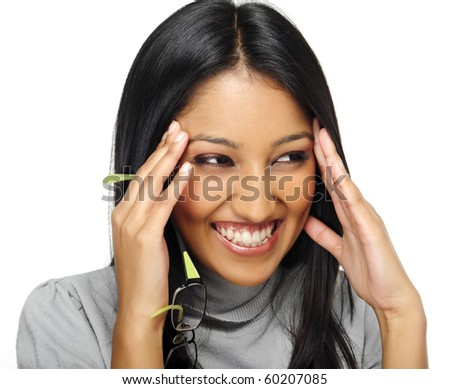 Cute Indian girl laughs and touches her face - stock photo