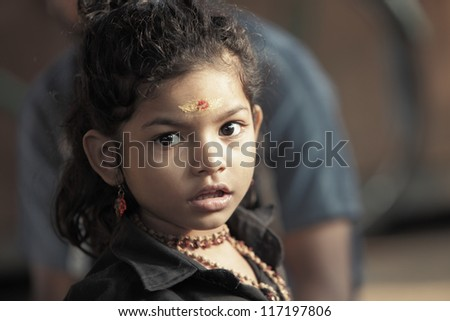 Cute Indian portrait looking at the camera. - stock photo