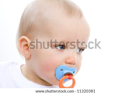 Cute infant with pacifier in mouth.  Focus on right eye. - stock photo