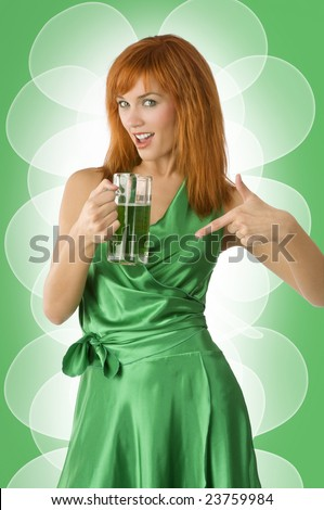 cute irish girl in green dress showing happy a glass of green beer