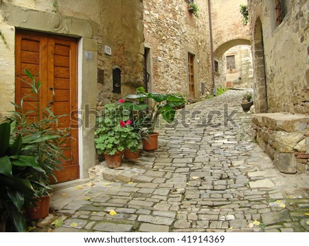 cute italian street in village Montefioralle, sometimes claimed to be the birthplace of Amerigo Vespucci, Greve in Chianti, Italy, Europe - stock photo