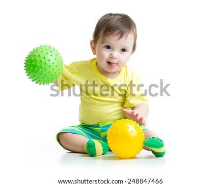 cute kid boy playing with massage ball - stock photo