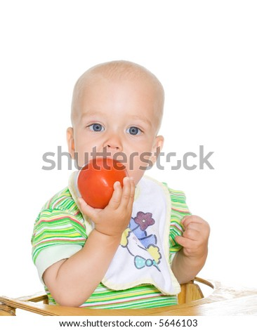 Cute kid eating red tomato. Isolated. 2 - stock photo