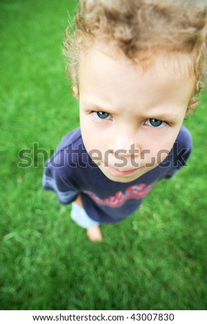 Cute kid facial expression - stock photo