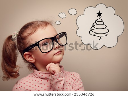 Cute kid girl in glasses thinking about gifts and fur tree on Christmas holiday. Concept. Closeup portrait - stock photo