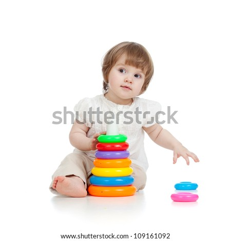 cute kid girl playing with toy - stock photo