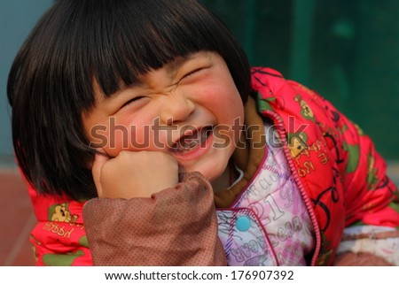 Cute kid grimacing and pretending pain  - stock photo