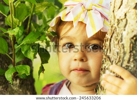 Cute kid is smiling in sunny summer day  - stock photo