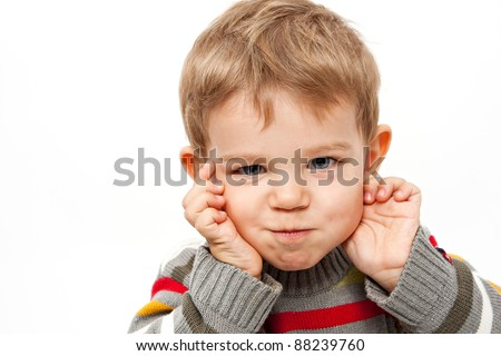 Cute kid isolated on white making a funny face - stock photo