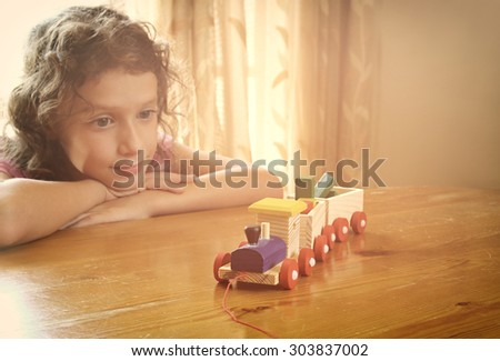 cute kid looking at old wooden train. selective focus. inspiration and childhood concept  - stock photo