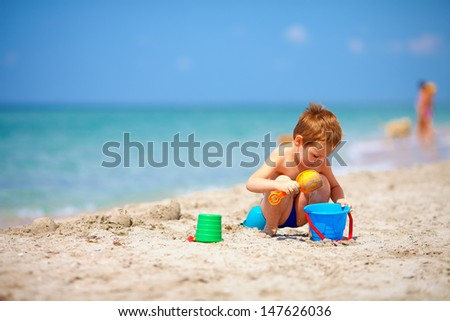 cute kid playing on the sea beach