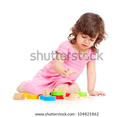 cute kid playing with colorful toys, isolated over white
