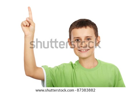 Cute kid pointing up, isolated on white background - stock photo