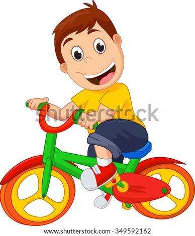 Cute kid riding his bicycle - stock photo