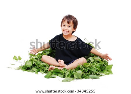 Cute kid sitting on leafs isolated - stock photo