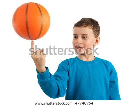 Cute kid spinning basketball on index finger, some motion blur on ball - stock photo