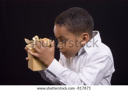 Cute kid with gold wrapped box