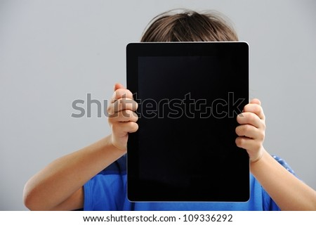 Cute kid with Tablet - stock photo