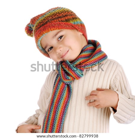 Cute kid with winter clothes isolated in studio - stock photo