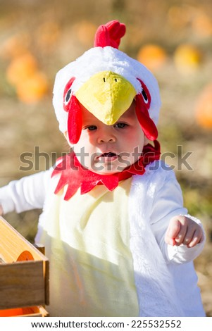 cute kids in halloween costumes at the pumpkin patch