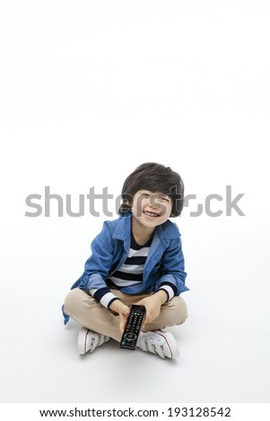 Cute Korean boy with remote control
