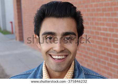 Cute latin american college student on campus - stock photo