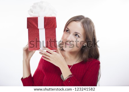 Cute latin woman wondering what's inside the box - stock photo