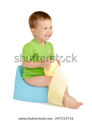 Cute laughing baby boy with toilet paper sitting on a blue potty isolated on white background - stock photo