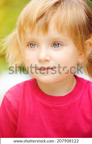 Cute liitle girl in a red t-shirt close-up - stock photo