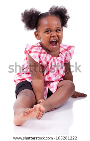 Cute little african american girl laughing, isolated on white background - stock photo