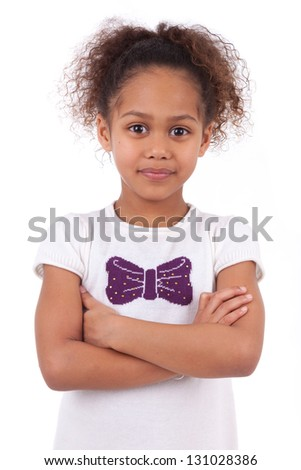 Cute little African Asian girl smiling ,with folded arms - stock photo