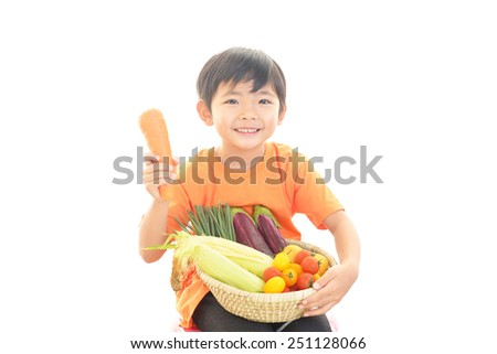 Cute little Asian boy smiling - stock photo