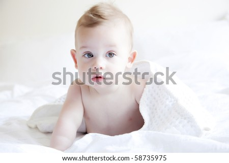 Cute little baby after bath, six months old - stock photo