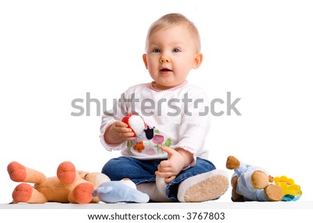 cute little baby girl playing with soft toys and a ball