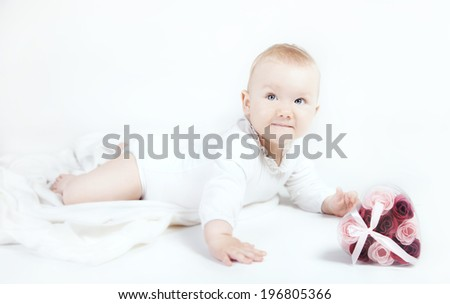 Cute little baby girl posing in studio over white background.