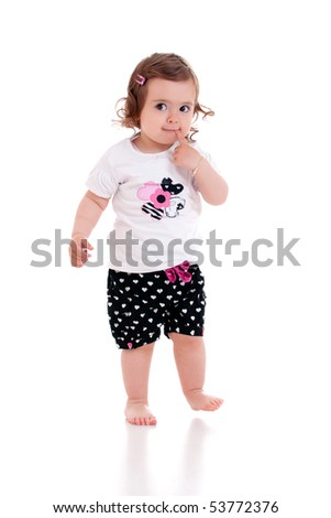 Cute little baby girl putting a finger in her mouth. Isolated on white background - stock photo