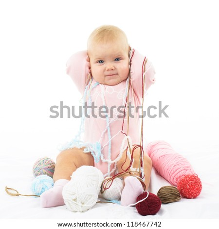 Cute little baby girl with colored thread isolated on white background