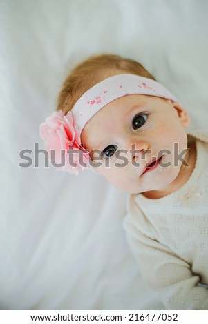 cute little baby girl with flower headband - stock photo