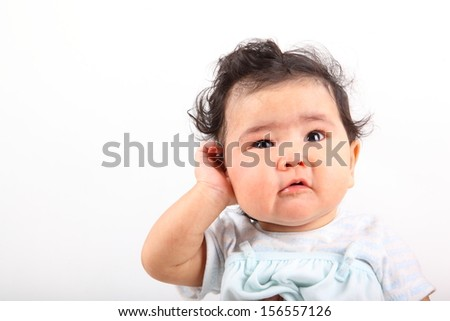 Cute little baby is talking on cell phone - stock photo