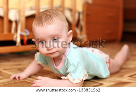 Cute Little Baby on the Floor in Home Interior - stock photo
