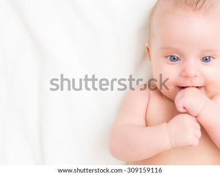 Cute little baby. Place for your text.