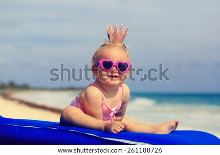 cute little baby princess on summer tropical beach - stock photo